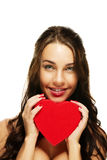Beautiful smiling woman with a red heart Stock Photos