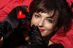 Beautiful smiling woman with red heart in hand Royalty Free Stock Images