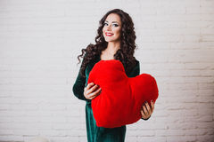 Beautiful smiling woman with red heart hands on Valentine's day Royalty Free Stock Photo