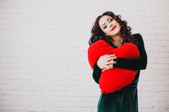 Beautiful smiling woman with red heart hands on Valentine's day Royalty Free Stock Image