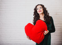 Beautiful smiling woman with red heart hands on Valentine's day Stock Image