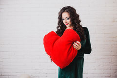 Beautiful smiling woman with red heart hands on Valentine's day Stock Images