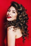 Beautiful smiling woman with red lips in red dress stock images
