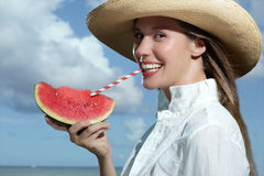 Beautiful smiling woman refreshing on the beach. Drink in the hand Royalty Free Stock Photos