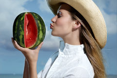 Beautiful smiling woman refreshing on the beach. Watermelon in the hand Stock Photography