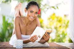 Beautiful smiling woman relaxing and book Stock Photography