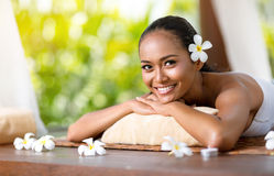 Beautiful smiling woman relaxing after massage royalty free stock image