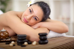 Beautiful smiling woman relaxing in spa center Stock Photos