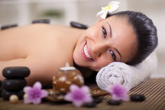 Beautiful smiling woman relaxing in spa center Stock Photography