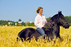 Beautiful smiling woman rides horse Stock Photos