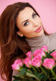 Beautiful smiling woman with roses Royalty Free Stock Image
