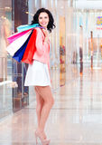 Beautiful smiling woman with shopping bags in mall Royalty Free Stock Photos