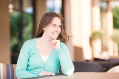 Beautiful smiling woman sitting in a cafe Stock Image
