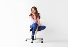 Beautiful smiling woman sitting on chair with copy space Royalty Free Stock Photos