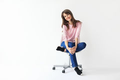 Beautiful smiling woman sitting on chair with copy space Stock Image
