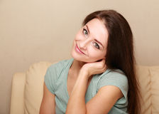 Beautiful smiling woman sitting on the sofa Stock Photo
