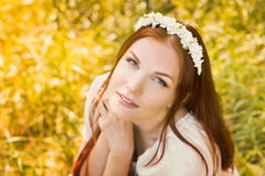 Beautiful smiling woman with spring flowers Royalty Free Stock Photos