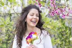 Beautiful smiling woman  in a spring garden Royalty Free Stock Image