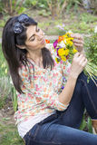 Beautiful smiling woman  in a spring garden Royalty Free Stock Photography