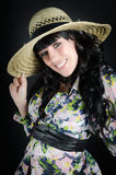 Beautiful smiling woman in straw hat Royalty Free Stock Photo