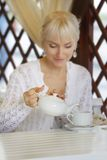 Beautiful smiling woman in street cafe Stock Photography