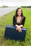 Beautiful smiling woman with suitcase Royalty Free Stock Images
