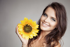 Beautiful Smiling Woman With Sunflower Royalty Free Stock Photography