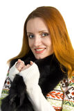 Beautiful smiling woman in sweater and fur Stock Photography