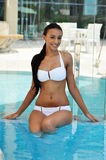 Beautiful smiling  woman in a swimming pool Royalty Free Stock Images