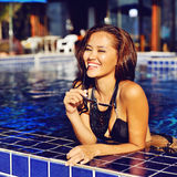 Beautiful smiling woman in swimming pool summer vacation Stock Photo
