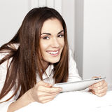 Beautiful smiling woman with tablet Stock Image