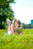 Beautiful smiling woman with tablet pc, outdoors. Beautiful youn Stock Photo