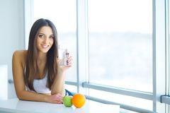 Beautiful Smiling Woman Taking Vitamin Pill. Dietary Supplement.  royalty free stock photos