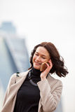 Beautiful smiling woman talking on a mobile phone Stock Photography