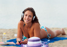 Beautiful smiling woman on tha sandy bech Royalty Free Stock Image
