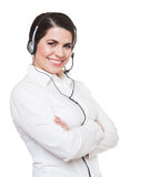 Beautiful smiling  woman using a headset, White background. Royalty Free Stock Images