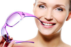 Beautiful smiling woman with violet sunglasses Stock Photos