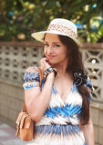 Beautiful smiling woman walking in hat Royalty Free Stock Photo