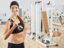 Beautiful smiling woman wearing black sports clothes Stock Photos