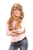 Beautiful smiling woman wearing fur hat Stock Photos