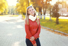 Beautiful smiling woman wearing a red leather jacket and scarf Royalty Free Stock Photo