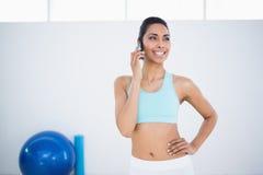 Beautiful smiling woman wearing sportswear phoning Royalty Free Stock Photography