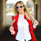 Beautiful smiling woman wearing sunglasses. Outdoor fashion port Royalty Free Stock Photo