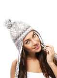 Beautiful smiling woman wearing a winter cap Stock Photos