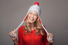 Beautiful smiling woman wearing winter clothing. Stock Image
