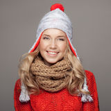Beautiful smiling woman wearing winter clothing. Royalty Free Stock Photos
