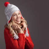 Beautiful smiling woman wearing winter clothing. Stock Photos