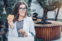 Beautiful woman went shopping with a gold card Royalty Free Stock Image