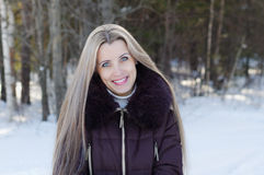 The beautiful smiling woman on winter walk Royalty Free Stock Photo