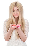 Beautiful smiling woman woman looking at pink roses Royalty Free Stock Images